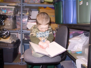Here is Tripp pretending to read while I work in my studio. Tripp and I spent many hours in parallel in my Anchorage studio.