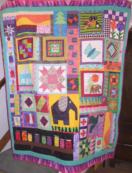 I think this is the last Valdez baby quilt I made. I still have one in a box. I'm just waiting for Christine to show up at my house for a marathon quilting session.