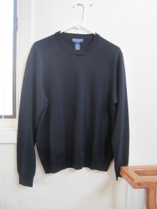 Here is your classic black merino wool sweater.