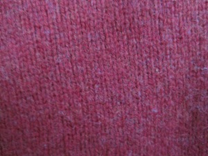 This sweater is a beautiful shade of red.