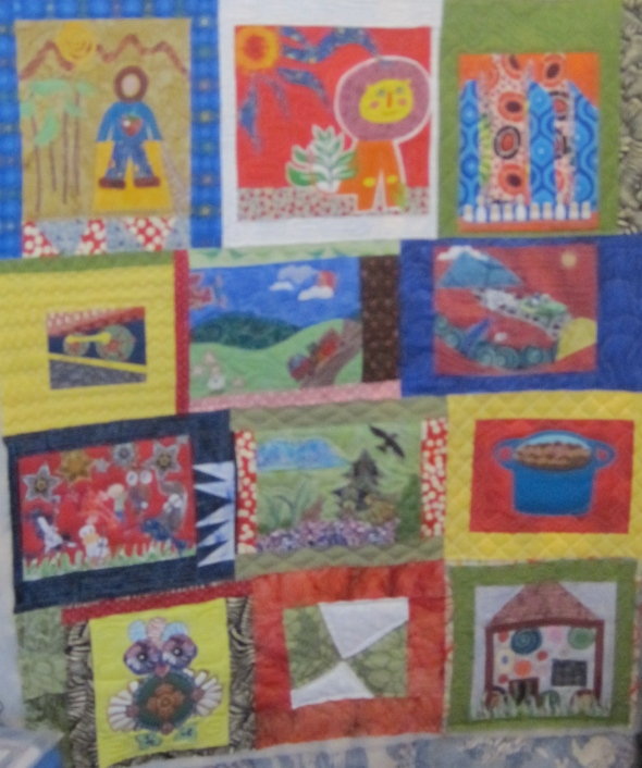 Here is the finished quilt. This is the only one of these quilts that have a block made by me--I am the owl in the left corner.