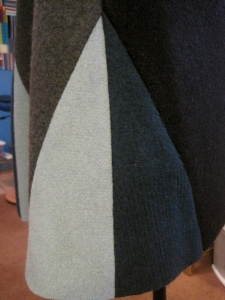 The skirt for this dress is slightly flared. It is pieced out of a center piece and two side pieces. All three of the sections have triangles added to them.