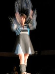Here is Beth flipping the head dress off. She looks like a baton twirler!