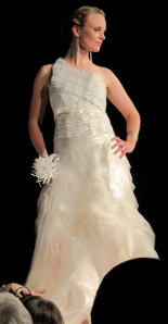 This is an amazing wedding dress composed of plastic twist ties and plastic bags. The model is Erin Frolander who partnered with Lynn Dixon to make this lovely design. The received fifth place.