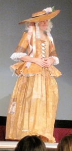 The Work Dress was first runner up. It was made entirely of discarded manilla envelopes and is modeled by herself.
