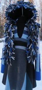 Here is the dress with the head dress I made out of sweater seams. My hope is that it looks like pelts.