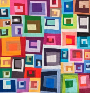 This is a more recent piece, put I am still messing around with traditional quilt blocks. These are all log cabin blocks. I'm students how to make their own version of this quilt at the Quilt Zone this spring.