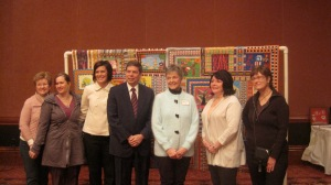 Here is Senator Begich with thread staff and board members.