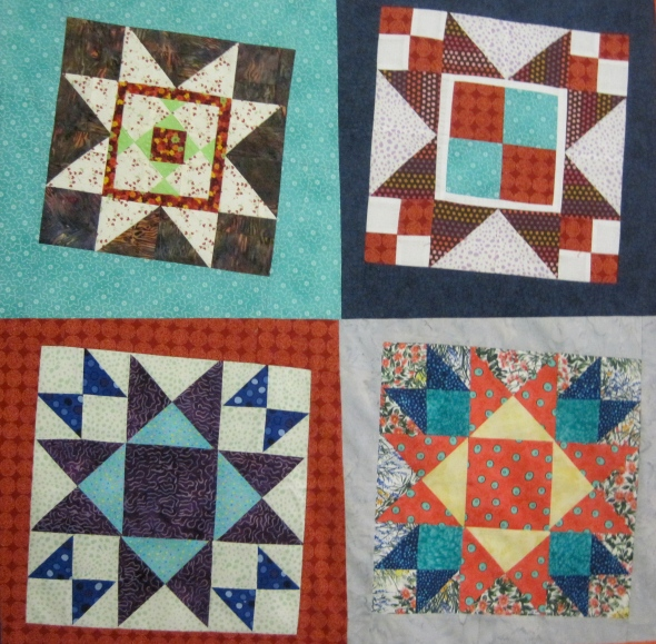 """You can see that the upper left block is smaller, but I just added a larger sashing to make it 15"""" by 15""""."""
