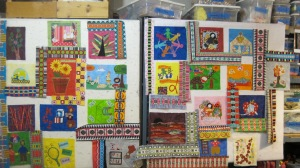 Here is a very early photo of the quilt. My first move is always to just put the blocks on the wall and see how they get along with each.