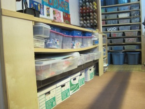 All my thread, rulers, and magazines are stored here behind the long arm.