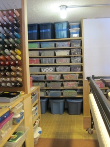 I have the same type of fabric storage all the way around the room.