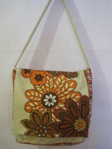 This year for the Surface Design Association's Conference instead of getting a new bag at the conference, show organizaers are incouraging participants to up-cycle a bag and trade it with another member. Here is the bag I have been working on.