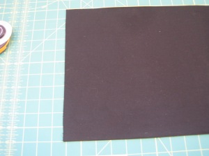 I fold my fabric in half width wise and iron it. Then I fold it again and iron it making sure that I do not have any creases that will affect my cutting. I place the fabric on the mat grid line it up with both horizontal and vertical grid lines. I am right handed to I place the fabric so the edge is in front of me and the excess fabric flows to the right. I would do the opposite if I were left handed.