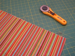 Again, I iron the fabric. I only fold it once, just like it came off the bolt. I straighten the edge but I do not use a ruler to do so.
