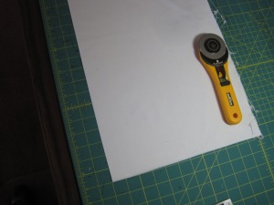I then line my fabric up using the gridlines on the mat. If I am working with yardage I move to my cutting mat that is big enough to accommodate more fabric.