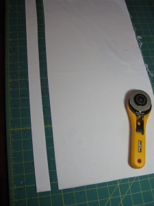 "I then make the cut. I cut moving the blade away from me. Before I start cutting I think about the size I want. I tell myself that I want to cut a 1 1/4"" strip, I visualize it, and then using the guidelines on the mat, I cut. This gives me a personally cut line which is much more interesting than a ruler cut line. But it is not so crazy that I can't stitch it accurately."