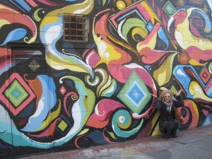 My friend Jen in front of a mural we saw the day we went to the Arc Show.