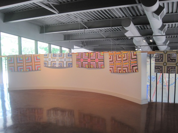 Here are the quilts resting on the ralings of the gallery.