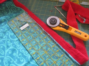 You should trim the edge to be 1/4 of an inch. It can be smaller, but not larger. A larger seam will not fit inside the binding.