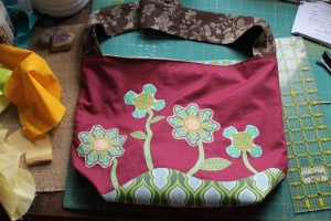 Here is a close up of the front of the tote. We used an other tote to create the pattern. Kristin did all the surface design.