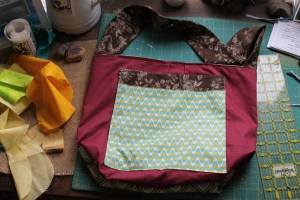 The backside of the tote features a fun pocket.