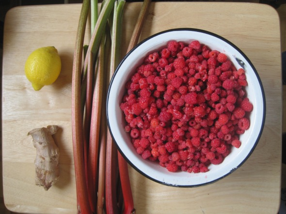 Besides sugar, all you really need to make this jam is lemon, ginger, rhubarb, and raspberries.