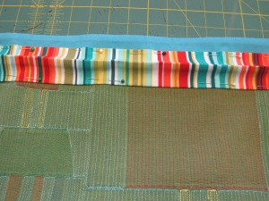 Sleeve pinned to back of quilt