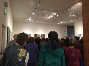 The crowd gathered for the opening of the SAQA exhibition Earth Stories at the San Jose Quilt and Textile Museum.